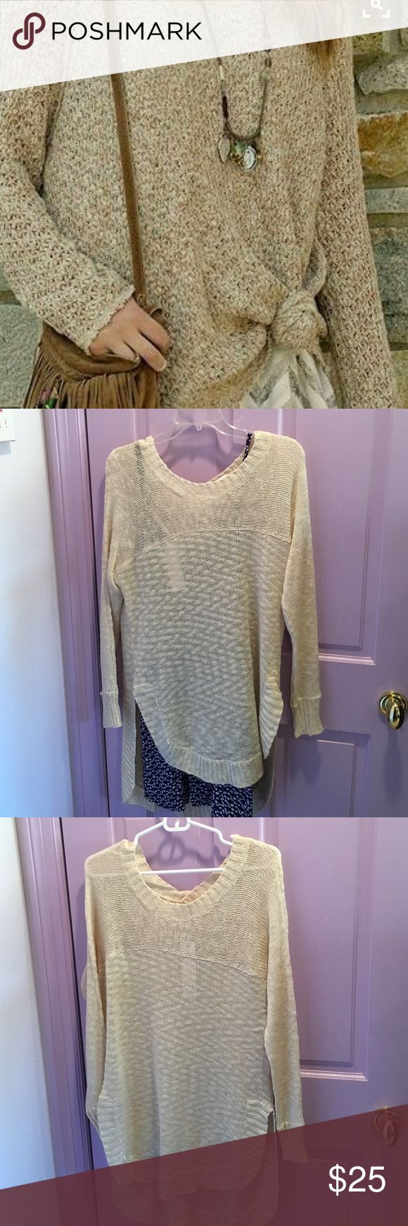 "Loose Knit Oversized Hi Low Sweater BNWT This sweater is perfect for layering! It's loose Knit lets what's underneath shine through, and its Hi low shape makes it perfect for dresses or leggings. Size M. 26"" long in front, 31"" long in back  17"" across the shoulder laying flat. BNWT, never worn, in perfect condition. Millau Tops Tunics"
