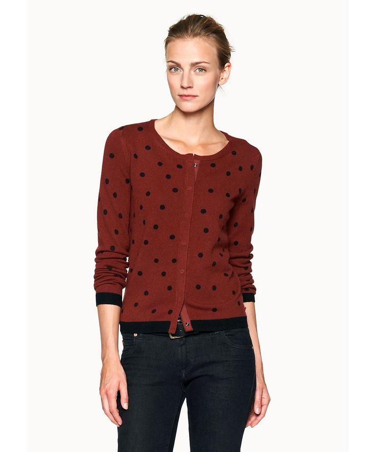 Die gepunktete Damen-Strickjacke ist ein Must-Have für diesen Winter. Durch den einfarbigen Siebdruck ist jedes Teil ein Unikat. 85 % Wolle, 15 % Baumwolle....