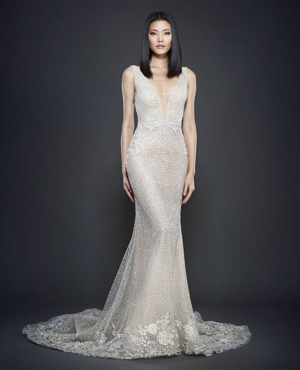 LZ3701 collection Spring 2017  Silver shimmer net over cashmere chiffon trumpet gown. Plunging V-neckline with criss-cross crystal straps at back. Floral embroidered applique accents at natural waist and hemline. Cathedral train. Available in champagne, ivory.  Dress in Store in early 2017.