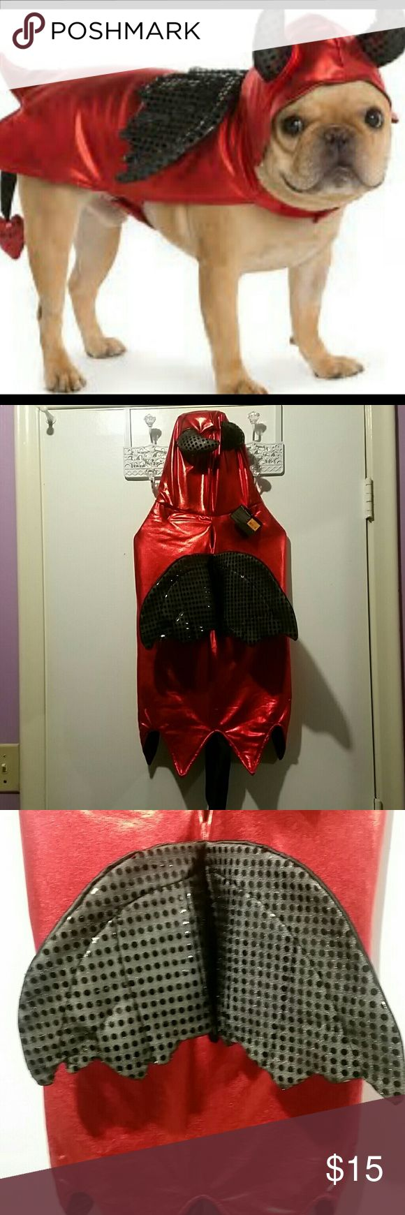 "Devil Costume Got this for my friend but she lost weight so it doesn't fit her anymore.  Brand New With Tags never worn.  Velcro closure at the neck and torso.  Metallic red with black sequins.  Measures 23"" from collar to tip of cape, not counting the tail.  sequin heart accent on the tail.  A show stopper.  Great for Halloween or dress up time with your master. Thrills and Chills Costumes Halloween"