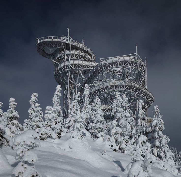 using only timber members and steel connectors, a 50-meter tall observation tower with a meandering continuous walkway offers 360-degree views of the jeseníky and krkonoše mountains.