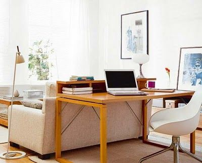 placing a desk behind the sofa. I love the way this looks and utilizes space.