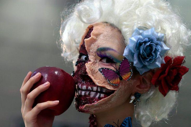 A participant poses after a Halloween parade in Kawasaki, Japan. (Yuya Shino / EPA)