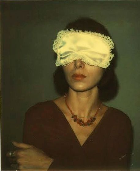"""Joyce Baronio in sleeping Mask "" 1973-74) Polaroid . By the artist Walker Evans (1903-1975)"