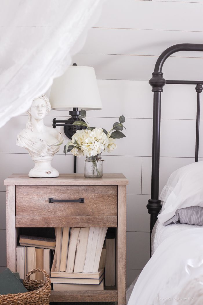 A clean and cozy farmhouse master bedroom