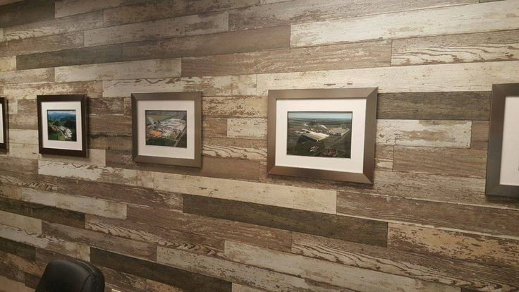 Laminate flooring looks great on a wall! One of the most popular decorating ideas of the last year has been using flooring planks to decorate a wall. You've probably seen these ideas on Pinterest or many home decorating TV shows. And whether it is a rustic, distressed barn wood look or a more formal dark wood like mahogany, laminate flooring is an affordable, easy way to go.