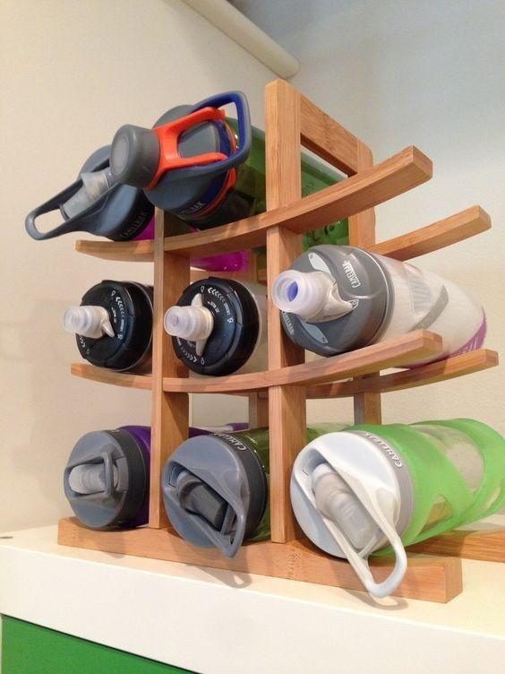 Make it easier to grab your reusable water bottles by storing them on a wine rack in your cabinet.
