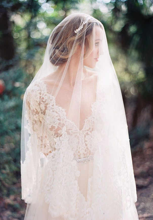 Veils are so gorgeous for outdoor weddings, they catch the light and blow in the wind.