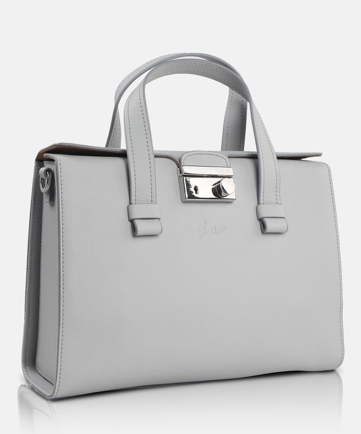 Giorgio Agnelli Women #leather #bag Padova D14G0542 Ice White  Simple minimalist hand  bag design. Material 100% Full Grain cow leather. Double leather handles. Front flap with easy lock clasp compartment    featuring 2 smartphone pocket and a zip security. Black, Blue, and Ice white color are available.