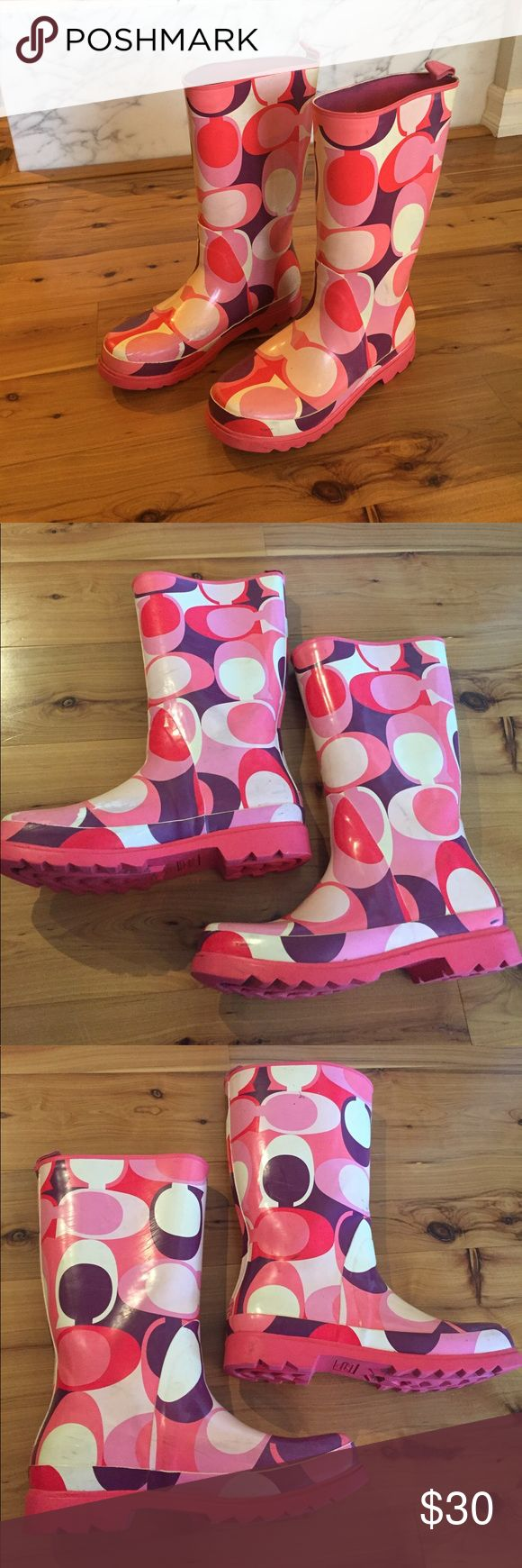 Coach Rain Boots Various shades of pink, white, and purple rubber rain boots. Very sturdy. Definitely worn and are dirty and scuffed but could be cleaned. They aren't super bad but worn. Price reflects the condition. Coach Shoes Winter & Rain Boots