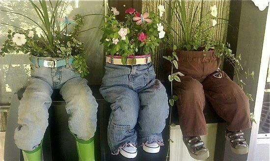 Pots with jeans pulled  up over then belted to hold them up, jeans stuffed with plastic bags or straw, then shoes or boots attached to the stuffing!