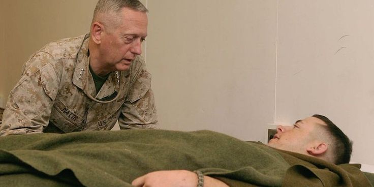 Lieutenant Gen. James N. Mattis, Commanding General, U.S. Marine Forces Central Command and I Marine Expeditionary Force, visits with a Marine at Camp Taqaddum's Shock and Surgical Trauma Platoon facility on Sep. 13, 2006.