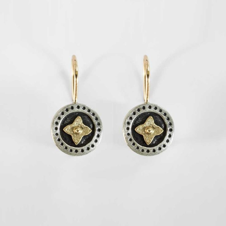 black and silver earrings with gold star detail