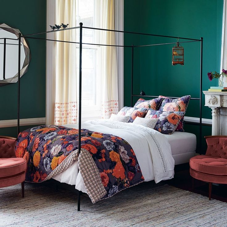 traditional bed room design with black wrought iron bed bloomed flower motif bed quilt and shams chic area rug red chair green walls of Do Trials on Colors in Your Bedroom with These Simple Bedroom with Colorful Bed Sheet