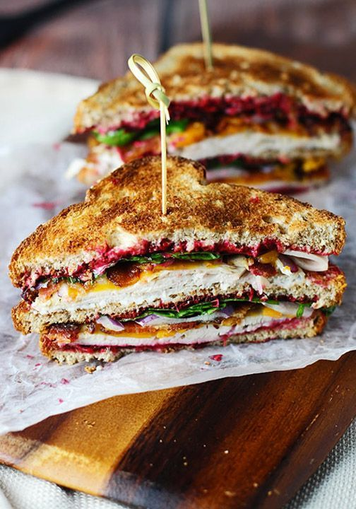 Utilize all of those delicious Thanksgiving leftovers by creating this Turkey Club Sandwich. Piled high with turkey and cranberry sauce, this easy recipe is great for feeding your family during the busy holiday weekend.
