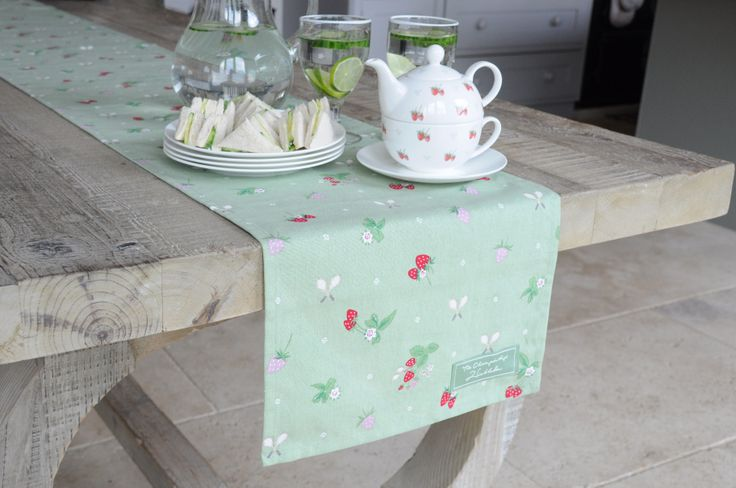 Wimbledon's 'Strawberry' design, by Sophie Allport. Available in Double Oven Gloves, Napkins, Tablecloth, Table Runner and more. From the Wimbledon shop.