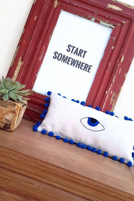 Boho accents with evil eye decor.