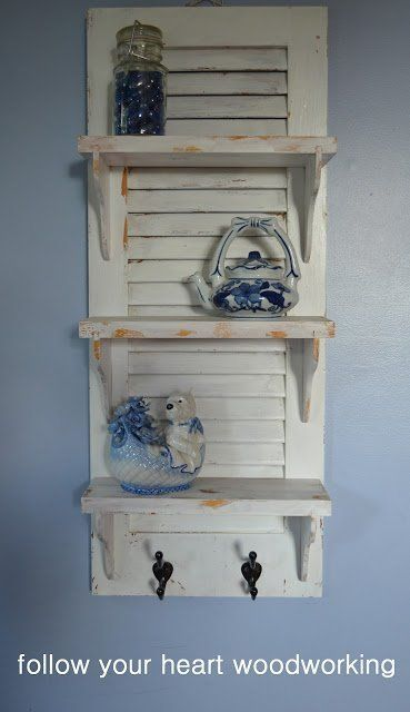 a shutter repurposed into a shelf by tammy