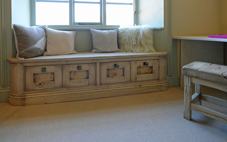 A bleached oak window seat with drawers below. See more on www.instagram.com/hallwoodfurniture