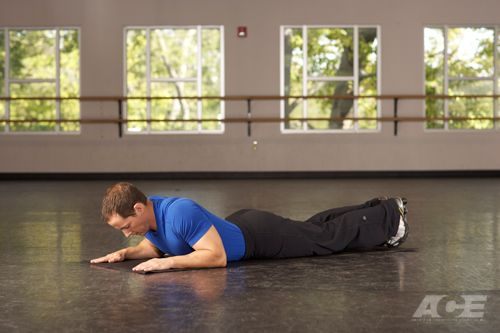 Step 1 Starting Position: Lie on your stomach on an exercise mat or floor with your elbows close to your sides and directly under your shoulders, palms down an