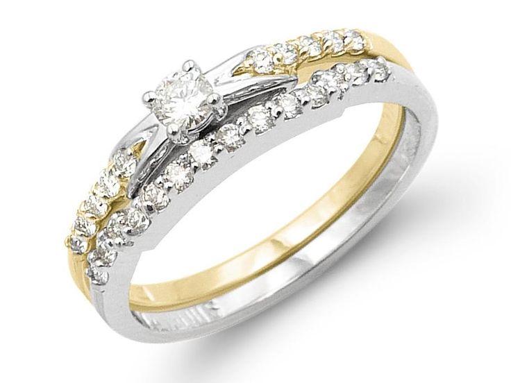 5 diamonds on each side of center and 14 diamonds on band. Weight center diamond: .09ctTotal diamond weight: .31ctGold: 14 karat