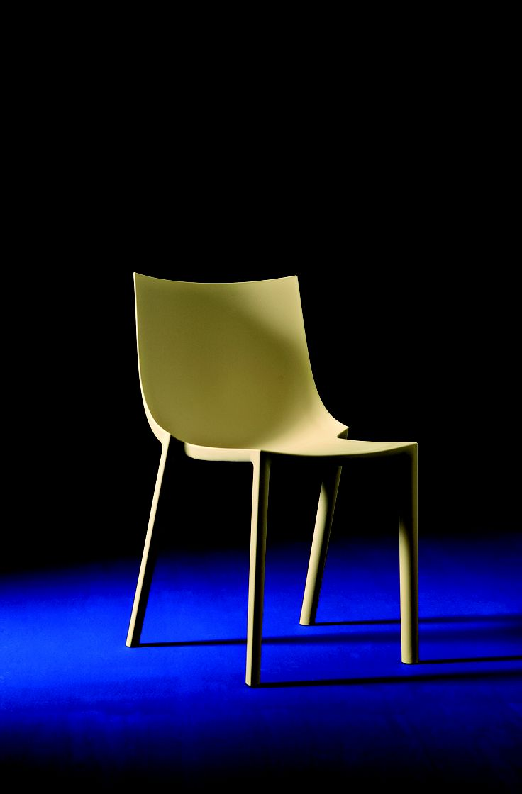 BO By Philippe Starck Stackable chair. White, beige, orange or grey polypropylene monobloc.