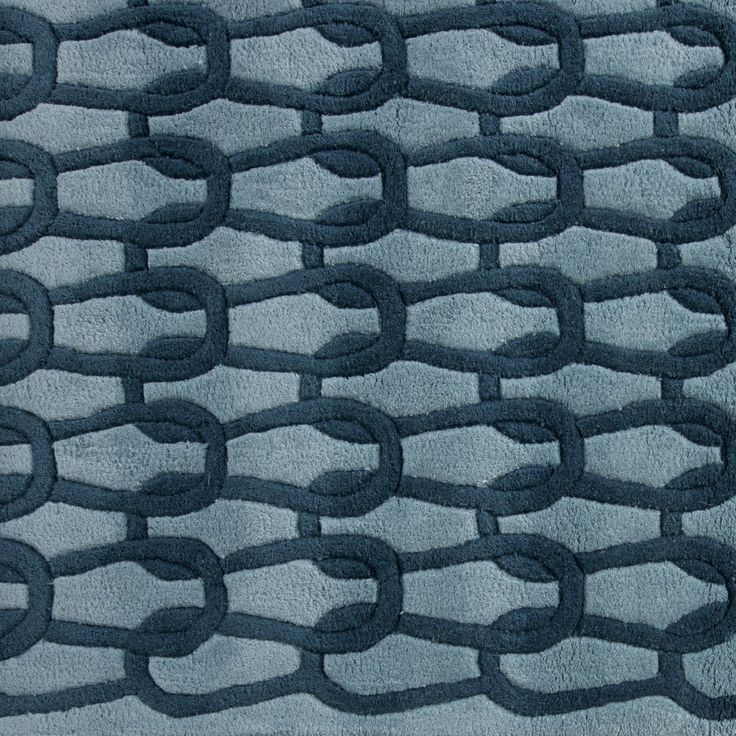 INGRID Rug in shades of blue. Sculpted motif evoking a steel weave , or perhaps a little equestrian. Standard 2 x 3 m or custom-made in 60 colours and size to choice