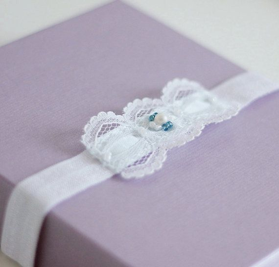 Vintage bridal garter, simple but cute toss garter, which has been hand-crafted from a white lace and aqua blue satin ribbon. I used blue rocaille