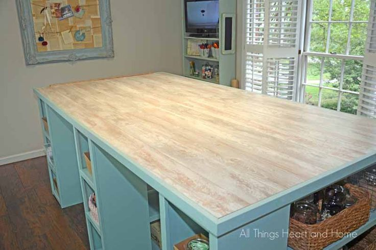 DIY Craft Room Table! (Guess What the TOP is Made Of???) | Spoiler Alert: it's wood laminate flooring. I think I'd prefer linoleum or something closer to tile (but with very little or no grout space, however one would do that).