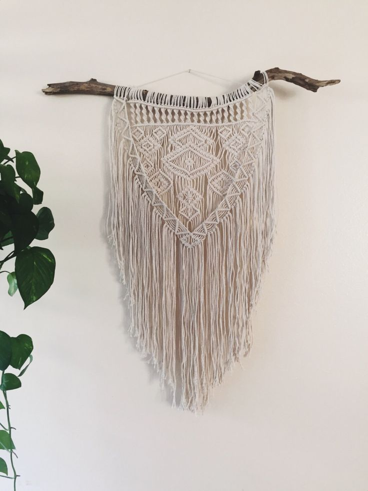 A personal favorite from my Etsy shop https://www.etsy.com/listing/492367555/macrame-wall-hanging-geometric-tapestry