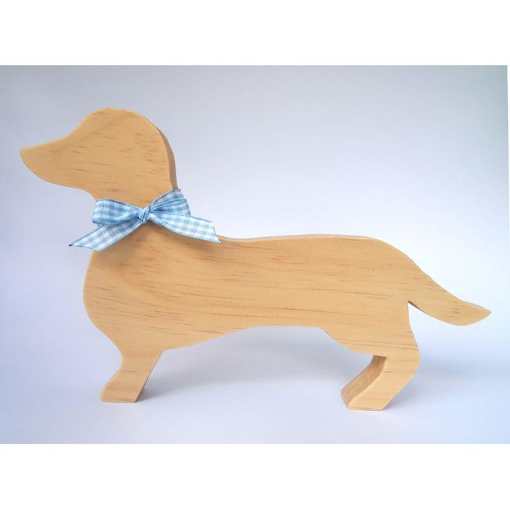 Simpledecorative Sausage Dog.A lovely gift idea or addition to any room of the house.Handmade from premium quality, sustainably sourced timber and finished in a clear matte varnish and ribbon.Dog will stand up on its own.Measurements: Height 145mm, Length 235mm, Width 18mmOther ribbon colours and stylesavailable. Due to natural variations in the grain of timber, your item may differ slightly from the picture. If you have any concerns please contact us.This item is for decorative…