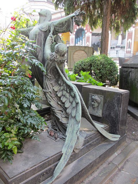 Angel comforting a grief-stricken woman - grave statues by Monceau, via Flickr