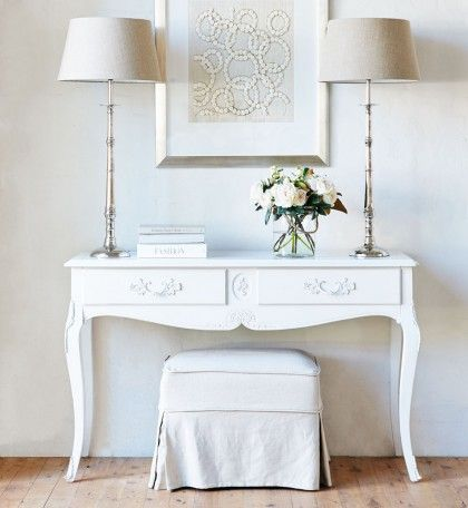Louis XV French Country Milan Console or Hall Table hand painted in Antique White. Features cabriole legs and wrought iron handles, this French Provincial furniture piece is made from solid hardwood.