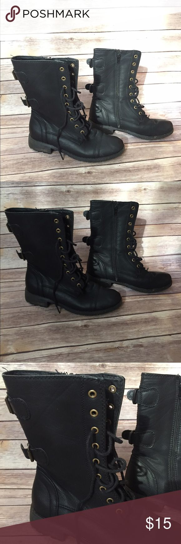 Black combat boots in good shape Had these for a few years but didn't wear them much. In pretty good condition. Most likely not real leather but the quality is good Shoes Combat & Moto Boots