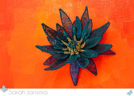 Wire Lotus on painted canvas by Sarah Jansma