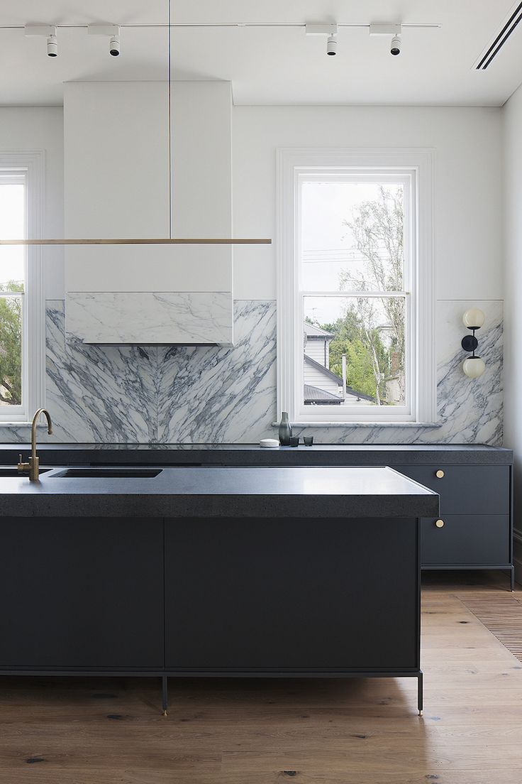 black countertops perfectly paired with a marble tile