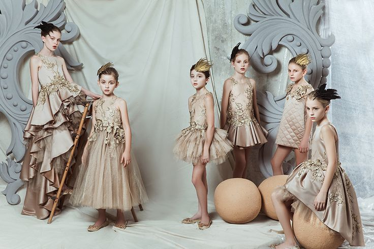 Swarosvki crystals and embroideries are made by hand on the Mischka Aoki collection girls dresses for fall 2015