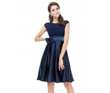Donkerblauw feestjurkje met strik in de taille. Super jurkje voor naar een bruiloft.