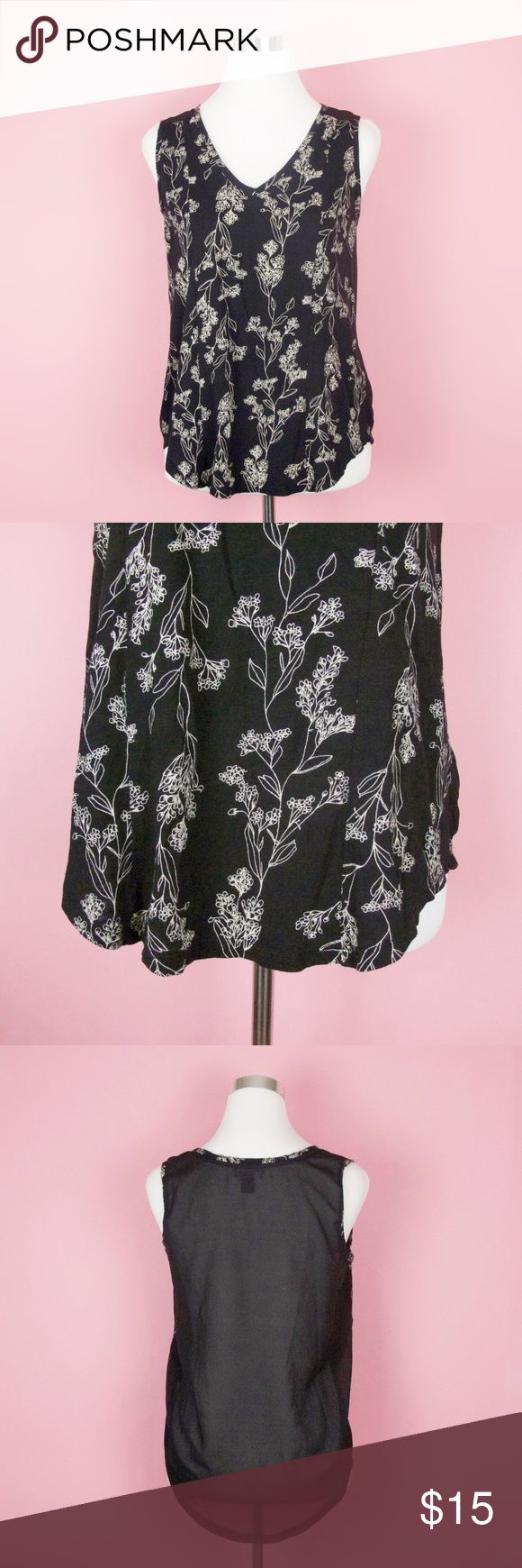 Old Navy Sleeveless Floral Blouse Sheer Back Tank Cute sleeveless blouse by Old Navy. Women's size small. In good overall condition. Black with beige floral outline. Sheer back panel. The front is 60% cotton, 40% modal. The sheer back material is 100% polyester.  Measurements (approximate): Bust: 36 inches, unstretched Total length: 25 inches Old Navy Tops Blouses