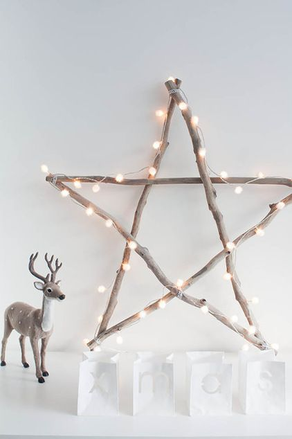 cut the found branches to equal lengths and attached the ends with string. To give the dark branches a pale look, she diluted white paint with water and applied this whitewash to the wood. Once the star was dry, she wrapped it with lights.