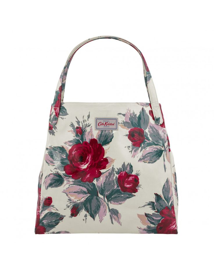 -Women's Cream Shoulder Tote Bag -Two top shoulder straps -Floral print all over -Magnetic fastening -Internal zip pocket -Cath Kidston branding no front -Press stud sides -Shiny oilcloth -High quality -Dimensions: 38 x 36 x 12 cm -100% PVC Coated Oilcloth -Care as according to brand