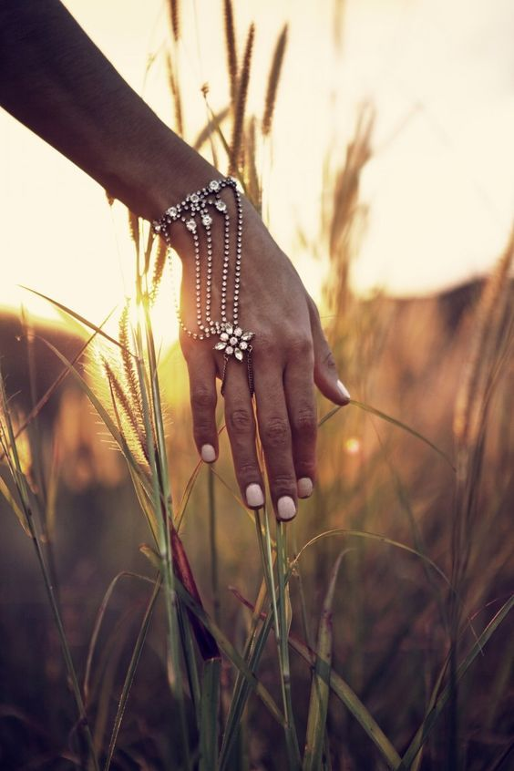 Get the luxe boho look with layers of hand chains and a soft, pastel essie nail polish.