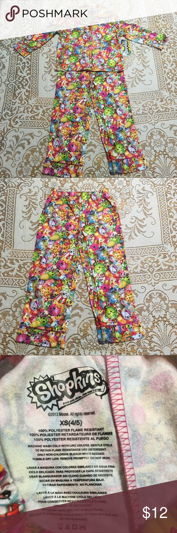"""NEW Shopkins Gang Girls Pajama Set NEW Shopkins Gang Girls  2 Piece Pajama Set  Long Sleeve Shirt  Pant Bottoms  Size  XS 4/5  Measures:  Shirt 13"""" from arm pit to arm pit,  Length 15 1/2"""" Pants 9"""" waist from right to left front (elastic waist), 22 1/2"""" length outer seam & 15 1/2"""" inseam  """"See our store for other Shopkin items""""  Smoke & Pet Free Home  IT#3000 Shopkins Pajamas Pajama Sets"""
