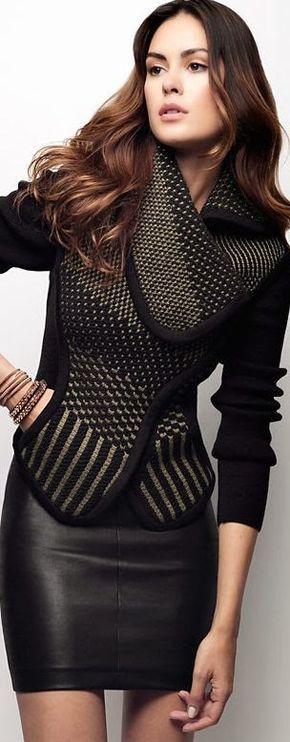 Luxury women fashion leather skirt and textured jacket.