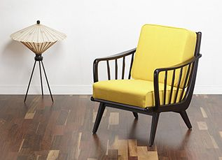 A truly striking 50s cocktail chair. The chair has slanted upwards armrests with vertical spindles which are also repeated on the back of the chair meaning that this chair displays nicely all the way round. www.viremo.co.uk