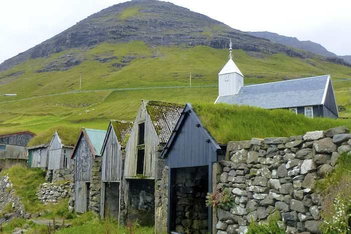Traditional, turf roofed Faroese boathouses