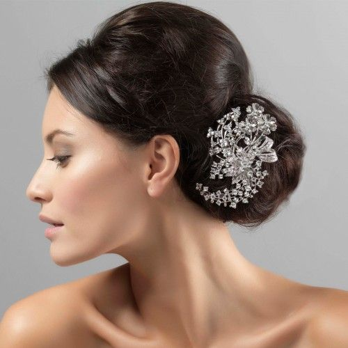 Inspired by antique headpieces, this romantic hair accessory features flowers, leaves and bows - perfect for brides who adore vintage jewels