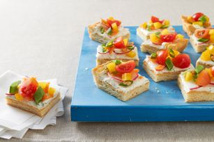 Spring Veggie Pizza Appetizer recipe - Pizza gets a smart redo with fresh veggies and cream cheese for an appetizer that celebrates spring in every bite.