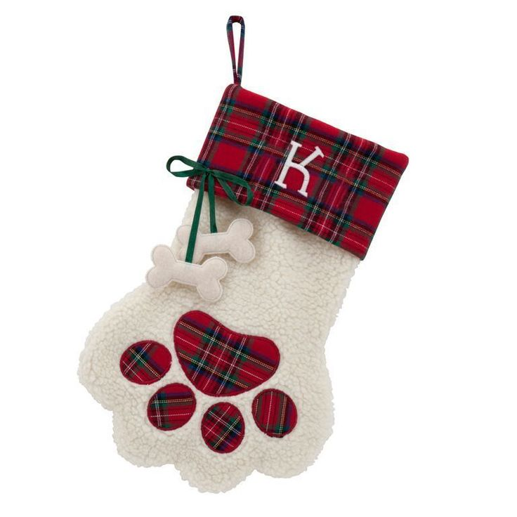 Make your canine companion feel part of the family with this Christmas pet stocking shaped like a paw and sporting dangling bone accents. Made from a poly blend with faux-sherpa and satin ribbon accen