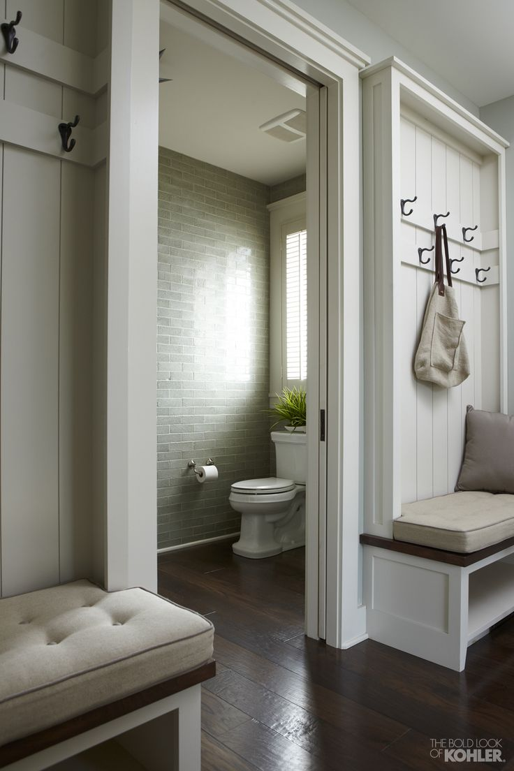A convenient mudroom off the kitchen offers plenty of seating and storage for family and visitors. Space-saving pocket doors close off the powder room and enhance the farmhouse vibe.